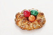 Bread wreath with pearl sugar and Easter eggs