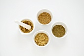 Spices in small dishes (coriander, aniseed, elderflowers)