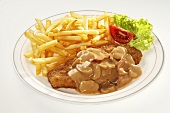 Pork escalope with chips and mushroom sauce