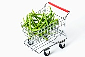 Green beans in toy shopping trolley