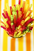 Many Colorful Straws in a Cup; Close Up of Tips