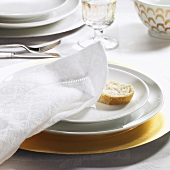 Festive place-setting with fabric napkin & slice of baguette