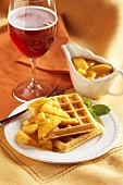 Waffles with Peach Topping; Cranberry Fizz