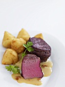 Medallions of venison with croquettes