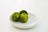 Three limes on plate