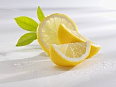 Slice of lemon and lemon wedges