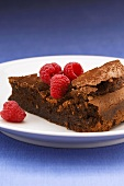 Piece of (flourless) chocolate cake with raspberries