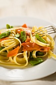 Salmon and Asparagus Pasta on a White Plate; Fork