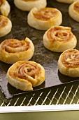 Several pizza pinwheels on baking tray