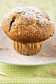 Stracciatella muffin with icing sugar
