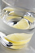 Glass of water with slice of lemon (close-up)