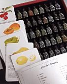 54 Duftaromen-Fläschen und versch. Karten mit Obst+Gemüse Abbildungen.