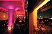 People in Au Quai Restaurant and Bar at night, The Port of Hamburg, Hamburg, Germany