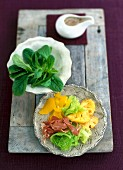 Mixed leaf salad with fried pineapple and Parma ham