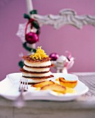 A tower of ginger mousse on a table laid for Christmas