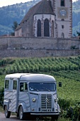 Landscape of wines in Alsace with small van on country road