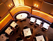Laid tables in restaurant of Chambers Hotel, New York, Overhead view