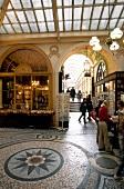 People at Galerie Vivienne passage in Paris, France