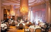 Laid tables in restaurant Alain Ducasse, Paris, France