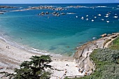 View of rocky coast and beach at Tregastel, Brittany, France