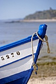 Close-up of the bow of fishing boat on beach at Cancale, Brittany, France