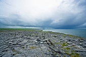 View of Burren with rocky lunar landscape and sea in Ireland