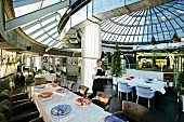 Interior of Restaurant Kupol with dome shaped glass roof, Moscow
