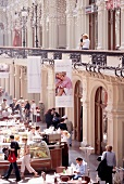 People relaxing at outdoor cafe in GUM department store, Moscow, Russia