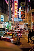 View of busy street of Hong Kong at night with advertising hoardings