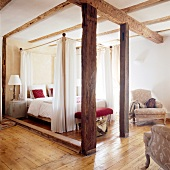 Rustic bedroom with canopy in Hotel de Charme, France