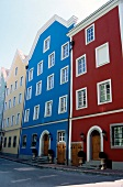Facade of colourful houses and street in Passau, Germany
