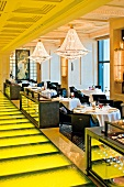 Laid tables in Caprice Restaurant at four Seasons, Hong Kong