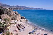 View of beach and rocky coastline in Nerja, Spain
