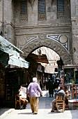 People walking on streets of Cairo's Khan-el-Khalili bazaar, Egypt