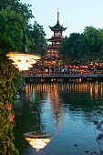 View of illuminated Chinese Pagoda at Tivoli Gardens in Copenhagen, Denmark