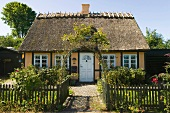 View of thatched yellow cottage in Oresund, Rungsted, Horsholm, Denmark