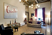 Waiting area with modern art and details of gold in Residenza del Moro, Florence, Italy