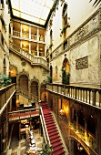 Hall with railings and staircases in Danieli hotel, Venice, Italy