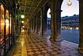 Sidewalk with arcades at Saint Mark's Square in Venice, Italy