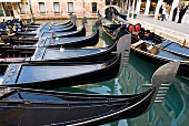 Several gondolas moored in canal, Venice, Italy
