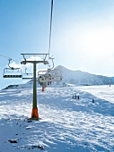 Ski lifts on snow covered mountain, Spain