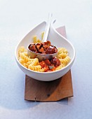 Fusilli with tomatoes, mushrooms and sausage