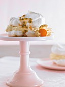 Meringue with passion fruit cream on a cake stand
