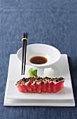 Tuna sashimi with a seaweed and pepper crust