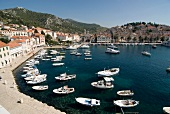 View of city and boats moored at harbour in Croatia, Dalmatia,