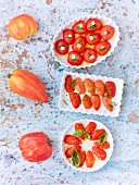 Three tomato-based dishes: oven-roasted tomatoes with garlic; with rosemary & thyme and with basil