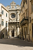View of white Baroque church with round window in Lecce, Italy
