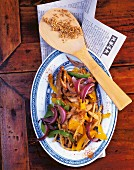 Stir-fried chicken with bamboo shoots, red onions and peppers