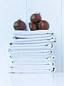 Black tomatoes on a stack of cloths
