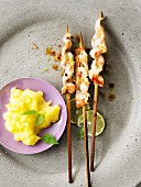 Sate skewers with mashed turnip